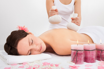 Woman Getting Herbal Compress Ball Therapy