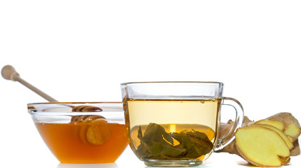green tea, ginger and honey over white background