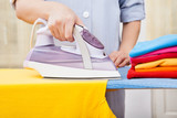 Maid Ironing Clothes