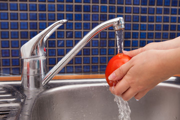 Woman Washing Tomato