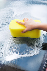 Hand Washing Windscreen With Yellow Sponge