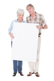 Senior Couple With White Board