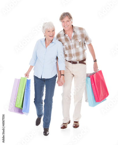 Seniors Couple Walking With Shopping Bag