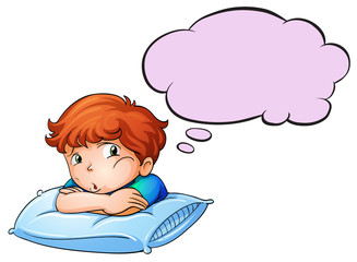 A young boy leaning over the pillow with an empty callout