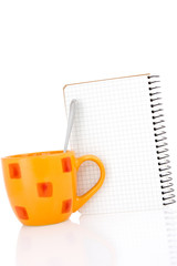 Coffee cup with a notebook