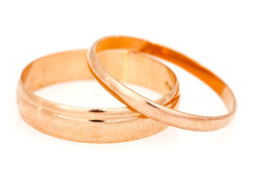 Golden rings on a white background