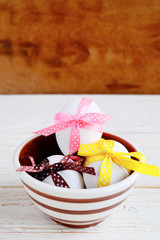 Easter eggs decorated with ribbons