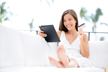 Woman shopping on tablet computer and credit card