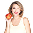 Portrait of a young smiling healthy woman with apple