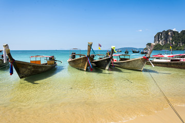 Longtail boats in Railay beach, Krabi peninsula in Thailand