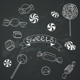 Cute set of doodle candies on chalkboard background
