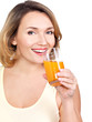 Portrait of a beautiful young woman with a glass of orange juice