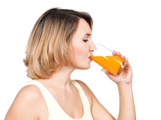 Profile portrait of a young woman drinks  orange juice.