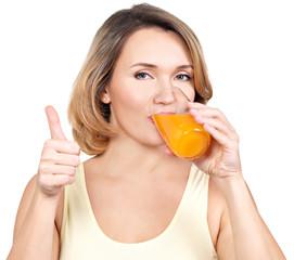 Portrait of a young woman drinks  orange juice.