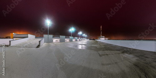 A empty Parking Lot at Night illuminatad by Neon Lights - 60677562