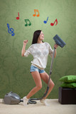 Girl sings while she tidies up the room, with colorful notes poster
