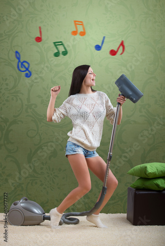 Girl sings while she tidies up the room, with colorful notes
