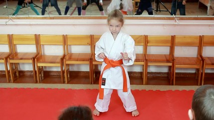 In rack karate a little athlete doing exercises