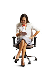 woman sitting on the chair and screaming