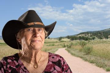 Senior lady wearing a black cowboy hat