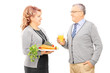 Mature couple holding plate full of vegetables