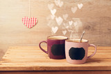 Cup of tea with chalkboard stickers  and heart bokeh