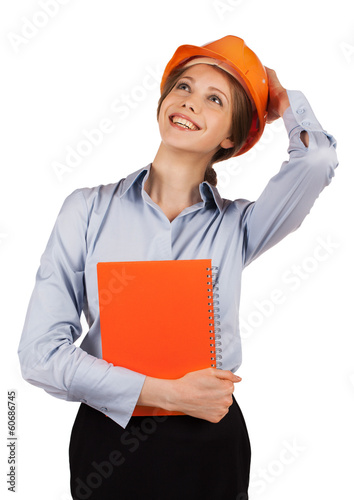 Girl in orange helmet looks up