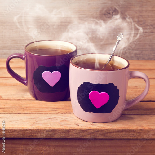 Fotobehang Thee Cup of tea with chalkboard stickers and heart shape