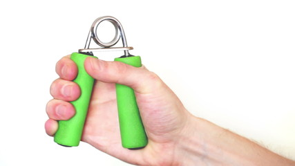 man's hand squeezes expander