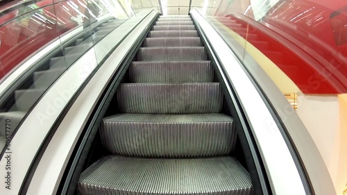 Rise on the escalator, moving escalator steps