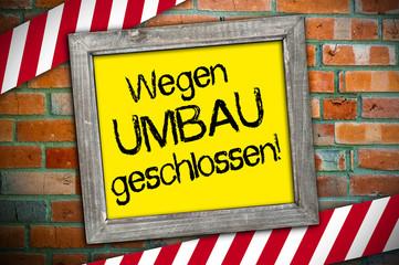Schild mit Ziegelsteinmeuer und UMBAU
