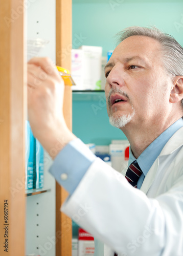 Portrait of a pharmacist searching for a product