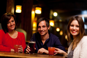 Friends having a round of drinks in a pub