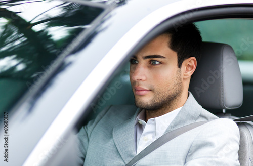 Portrait of a man driving a car