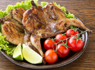 Grilled Quail with lemon and tomatoes