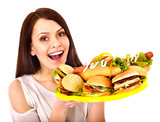 Thin woman holding hamburger.