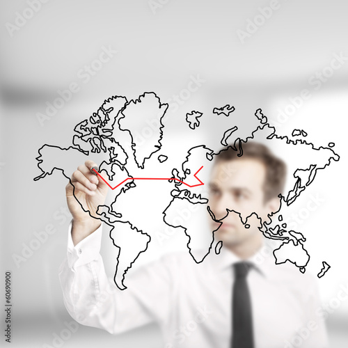 businessman drawing map