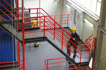 Industrial worker on stairs in a factory