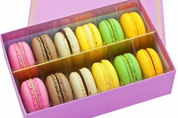 Dozen of macaroon biscuits in a box.