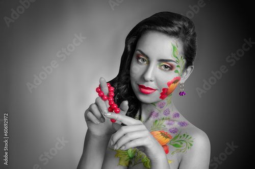 "Girl with ""flower"" body art. Black and white. Partly color."