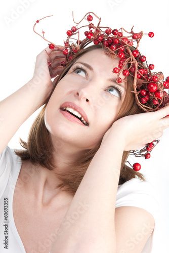 Pretty woman in wreath of red berries