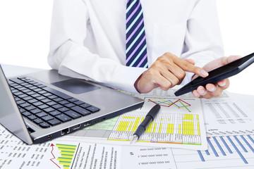 Accountant using a calculator