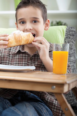 Young boy having breakfast