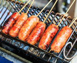 Grilled sausage that has pork and rice inside