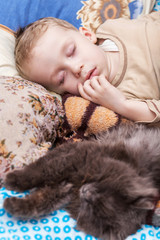 Boy sleeps with cat