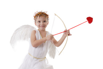 Smiling cupid boy aiming arrow