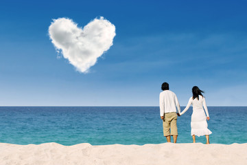 Couple enjoying honeymoon at white sand beach