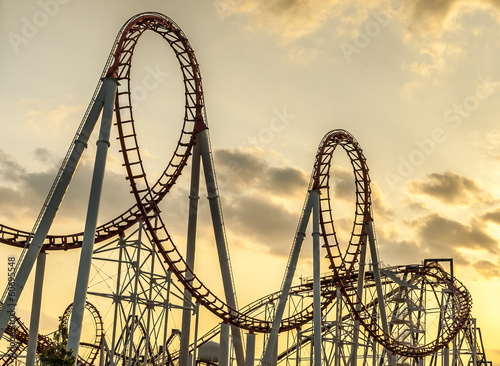 Leinwanddruck Bild Roller Coaster at Sunset
