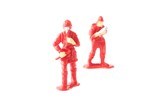 miniature toy fire fighter on white background