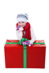 Beautiful little girl with big present box isolated on white